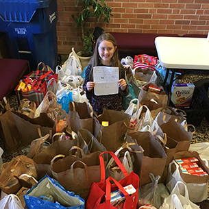 Ava Rojek is pictured with the donations she collected