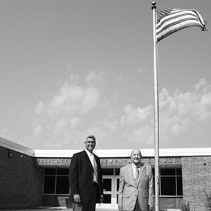 Paul Pietrantone and Bob Horvath stand in front of Ellicott Elementary