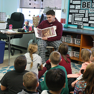 High School student reads to Elementary students